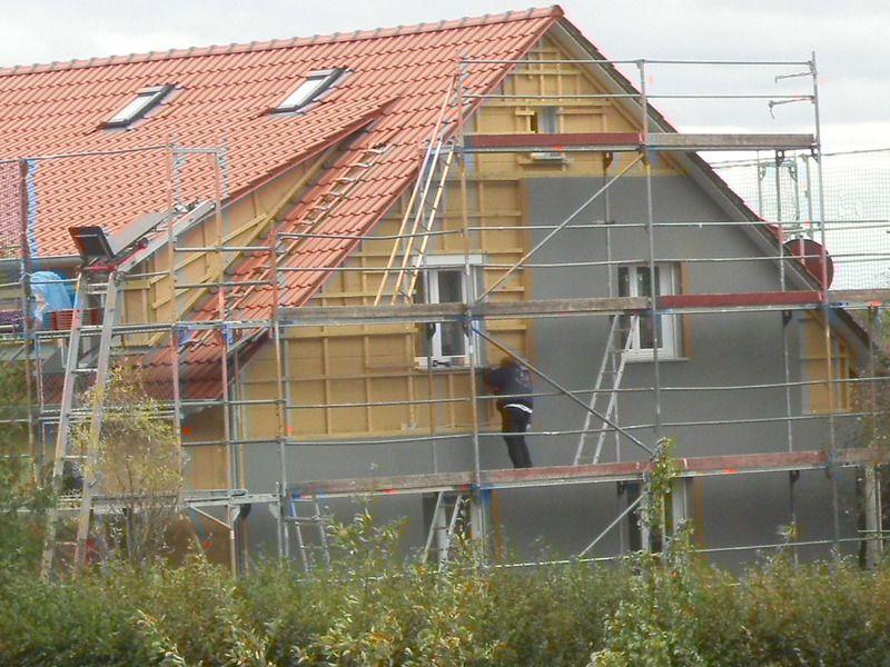 Dachumdeckung mit Aufdachdämmung und neuen Ziegeln